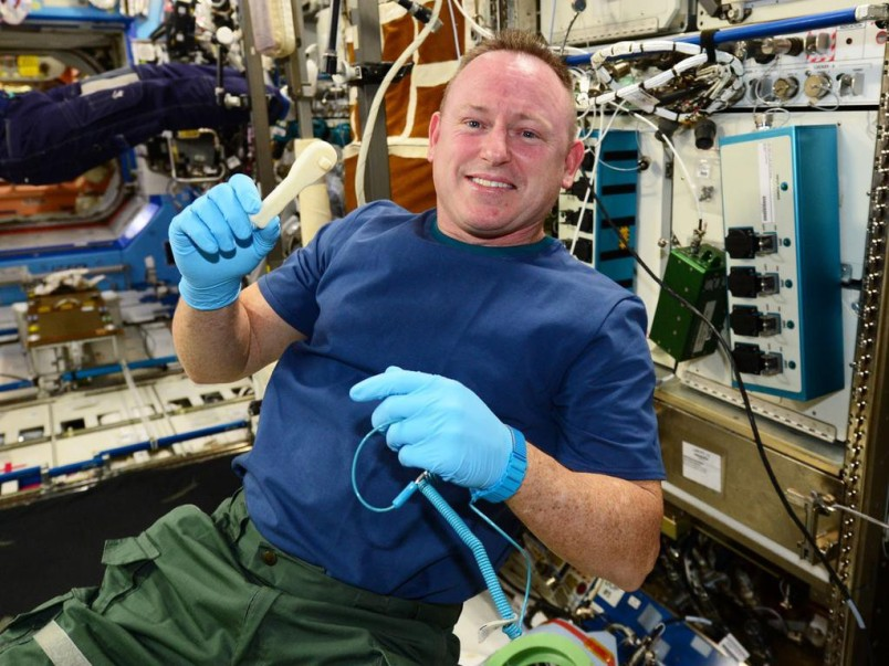 ISS commander Barry Wilmore with a ratcheting socket wrench printed on the International Space Station.