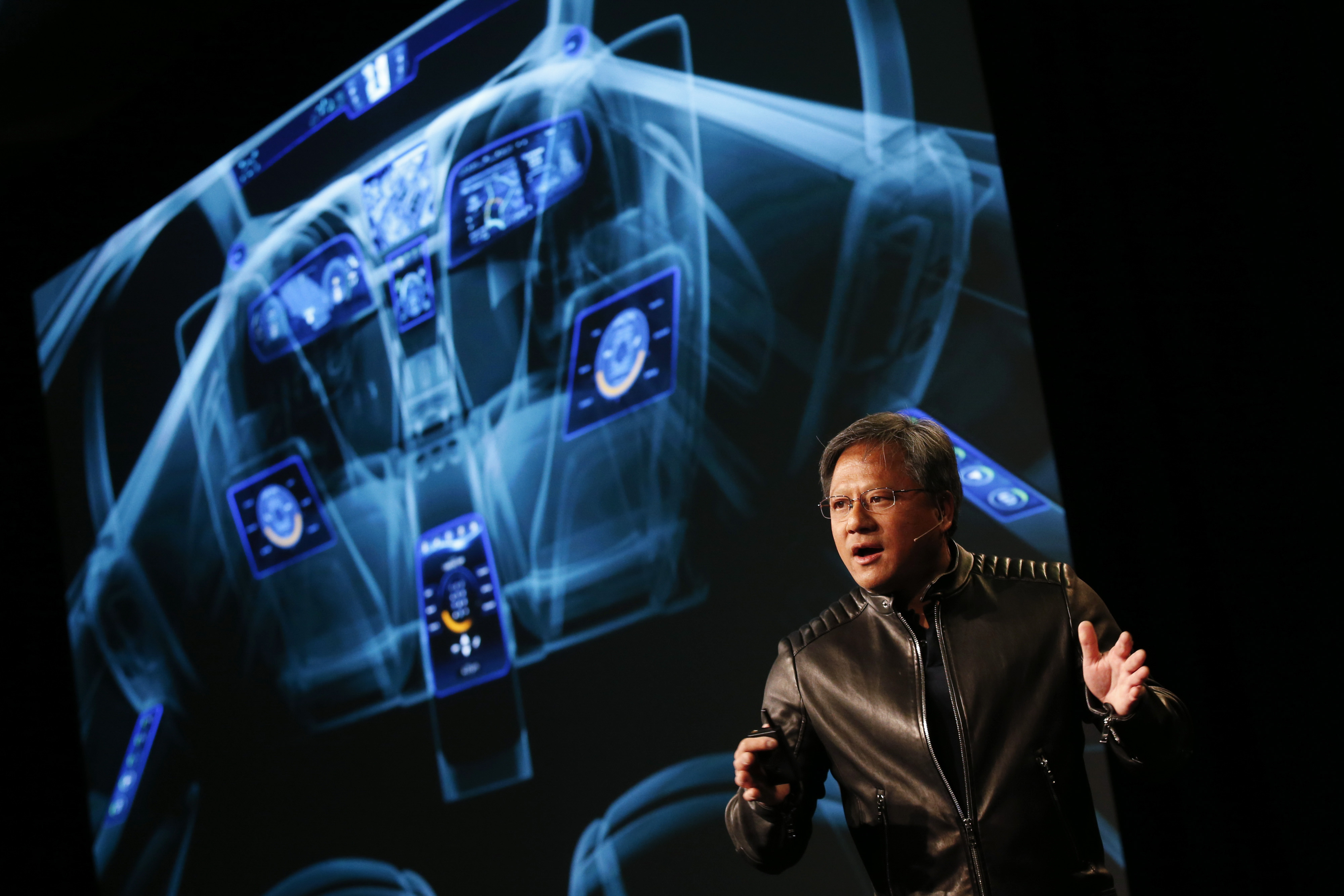 Jen-Hsun Huang, chief executive officer of Nvidia Corp., introduces the Drive CX Digital Cockpit Computer during a news conference ahead of CES on Jan. 4, 2015.