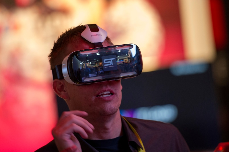 An attendee tries out a Samsung Electronics Co. Gear VR headset during the 2015 Consumer Electronics Show (CES) on Jan. 6, 2015.