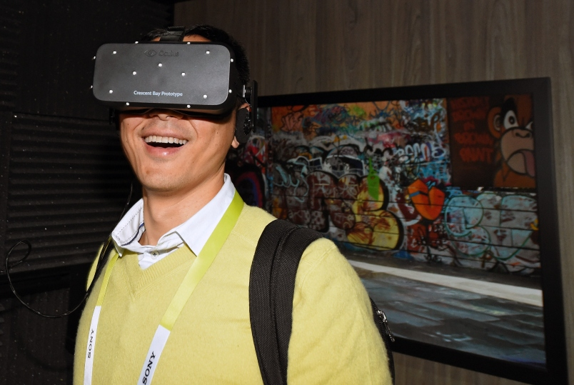 Bin Li of China tries out the Oculus VR Crescent Bay Headset prototype at the 2015 International CES on January 8, 2015.