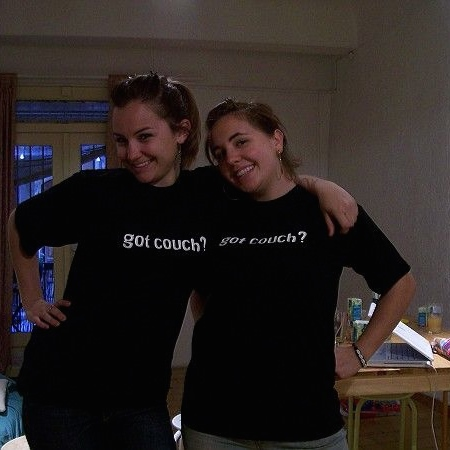 Christa Gallo (left) and a fellow member of the French Couchsurfing community rock company swag.