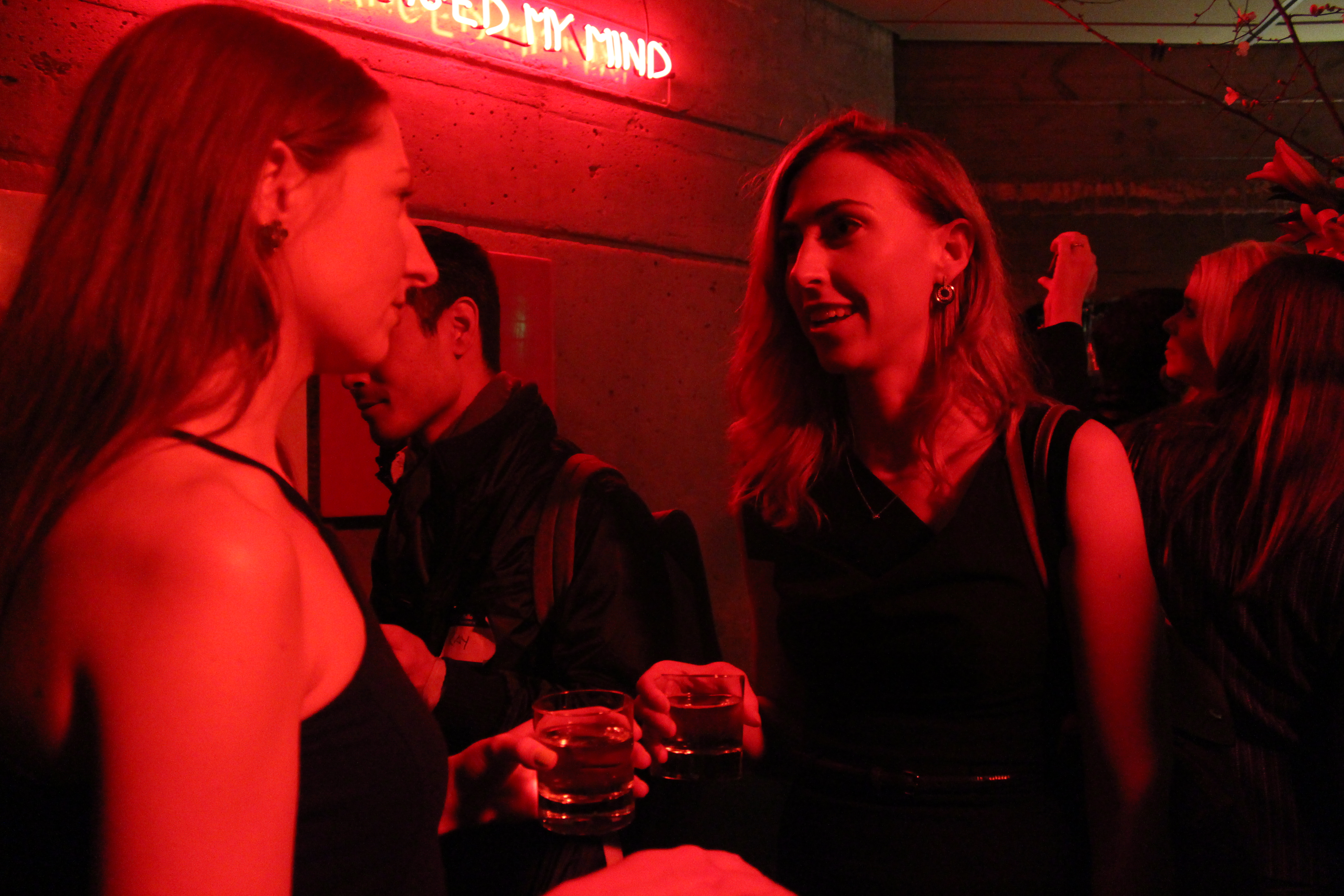Two women chat during Product Hunt's happy hour