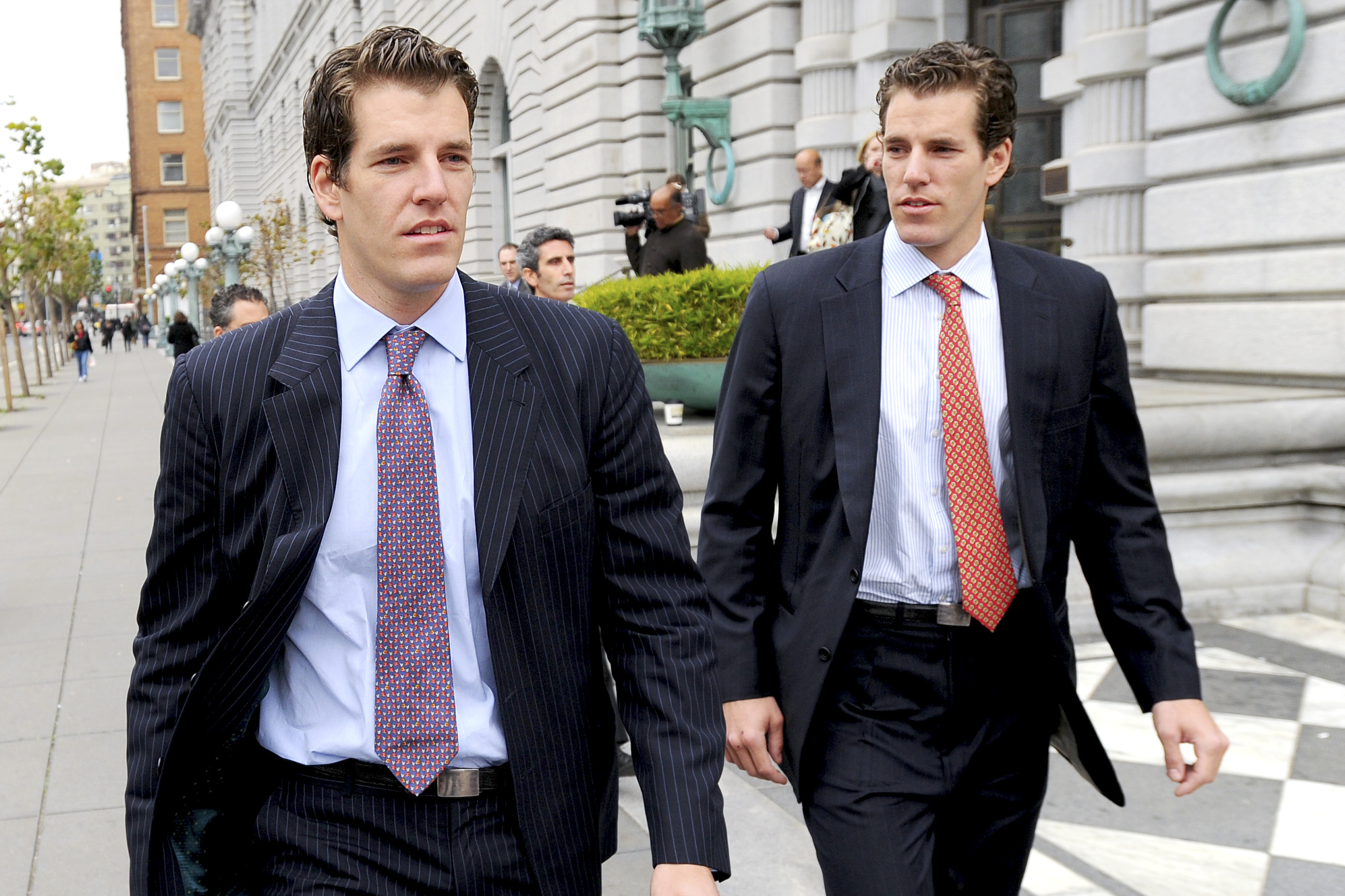 Tyler, left, and Cameron Winklevoss leave a courthouse in San Francisco on January 11, 2011.
