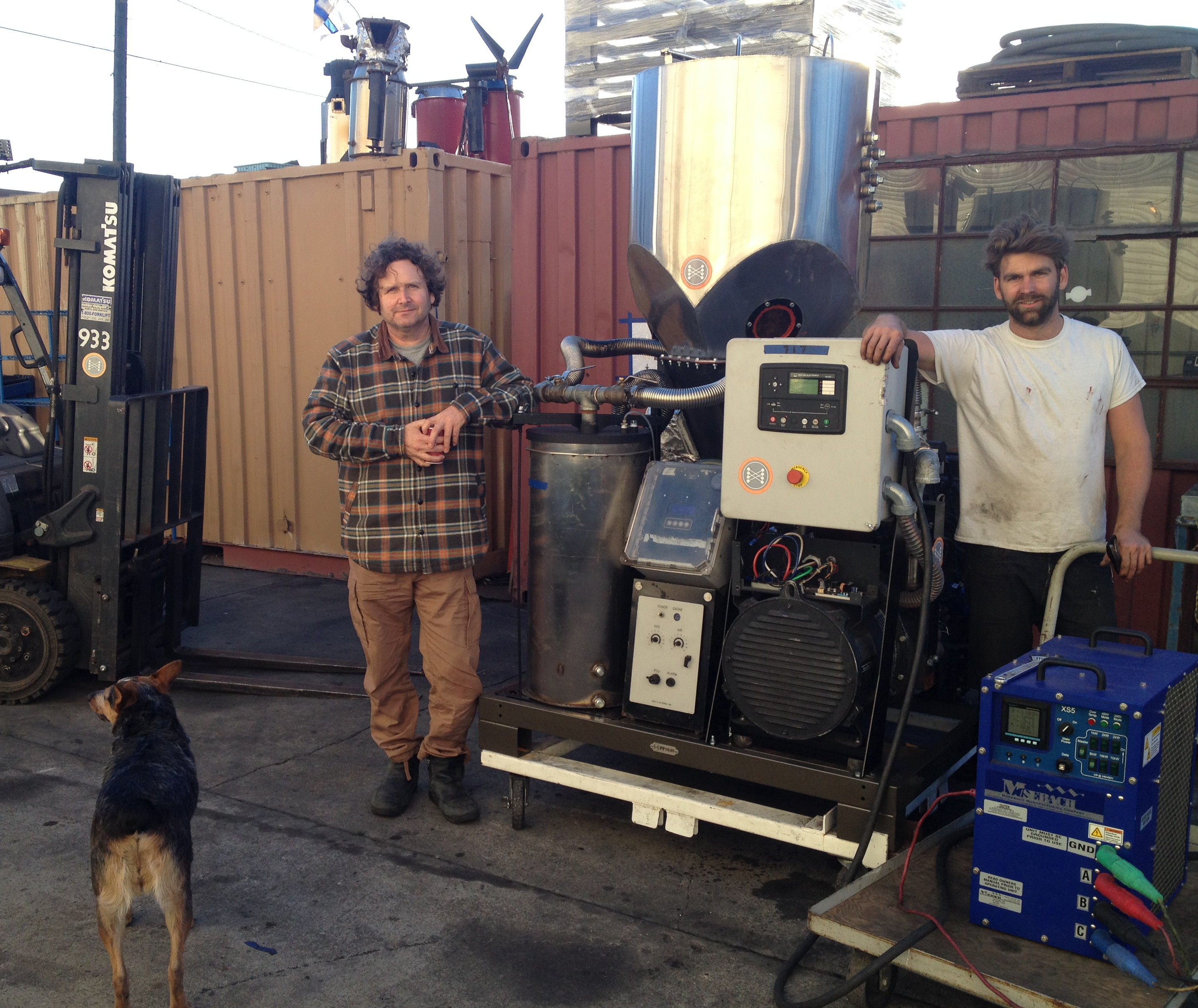 Co-founder and CEO Jim Mason, and Director of Infrastructure, Nick Bindbeutel, [L,R] stand in front of the Power Pallet, in the headquarters of All Power Labs, Berkeley, Calif. Dog and mascot Dulie in the foreground.