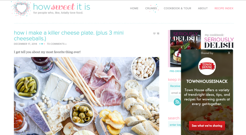 A pin about creating the perfect cheese plate links back to a personal foodie blog. Since the blogger has partnered with Ahalogy, Ahalogy placed an ad from crackers company Town House after the cheese pin started performing well.