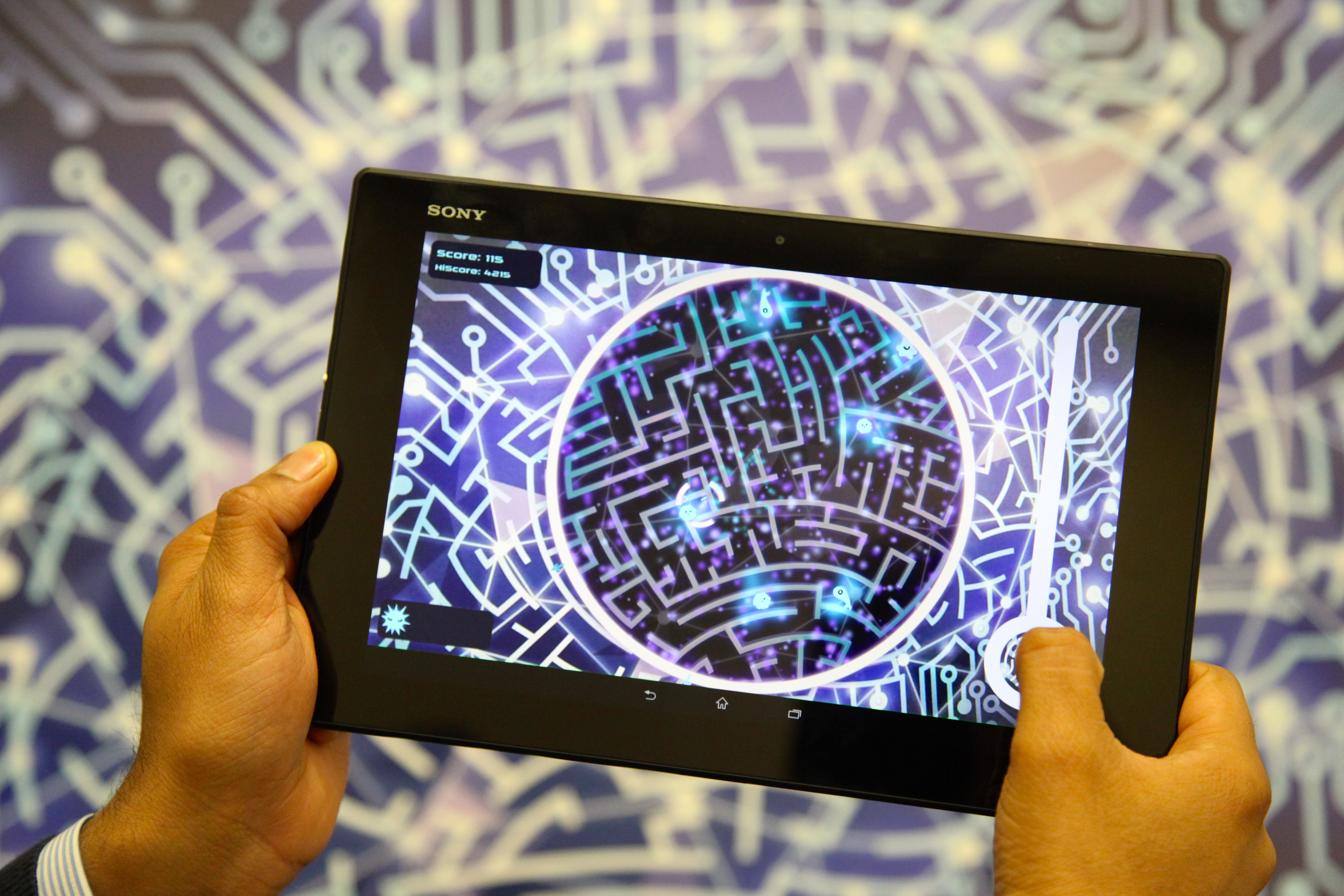 """MindMaze augmented reality recognizes a poster and lays virtual """"viruses"""" on top."""