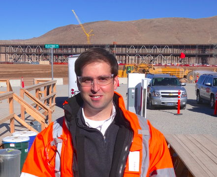 Tesla CTO JB Straubel standing in front of the battery factory under construction.