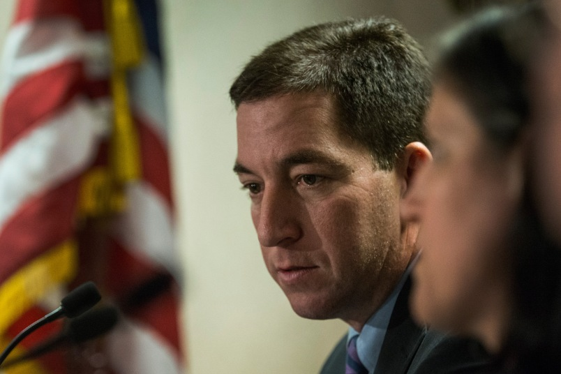 Investigative reporter Glenn Greenwald speaks at a press conference after accepting the George Polk Award along side Laura Poitras, Ewan MacAskill and Barton Gellman, for National Security Reporting on April 11 n New York City.